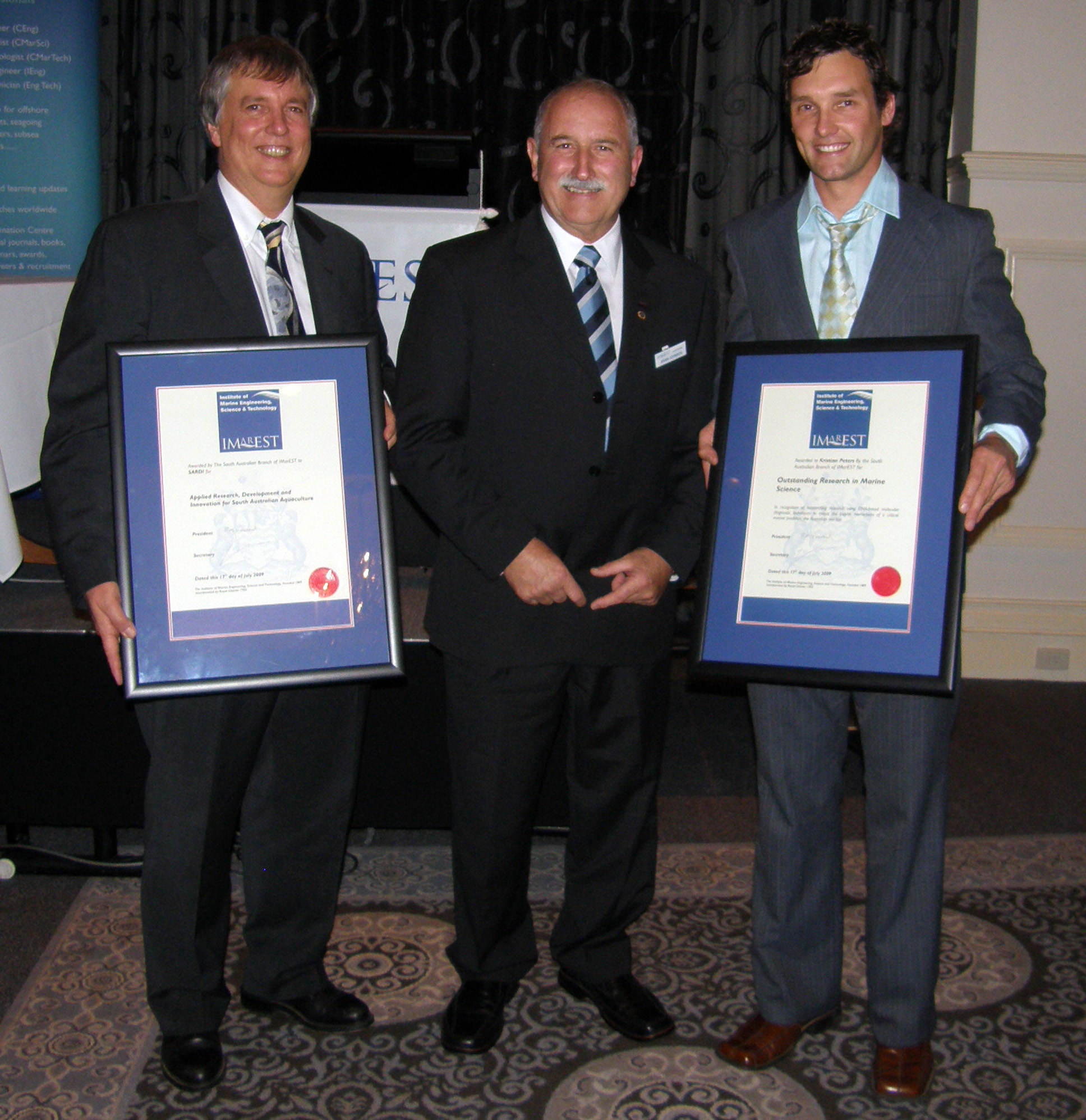 Steven Clarke and Kristian Peters accept IMarEST awards